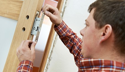 carpenter at ola door lock installation