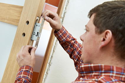 carpenter at door lock installation